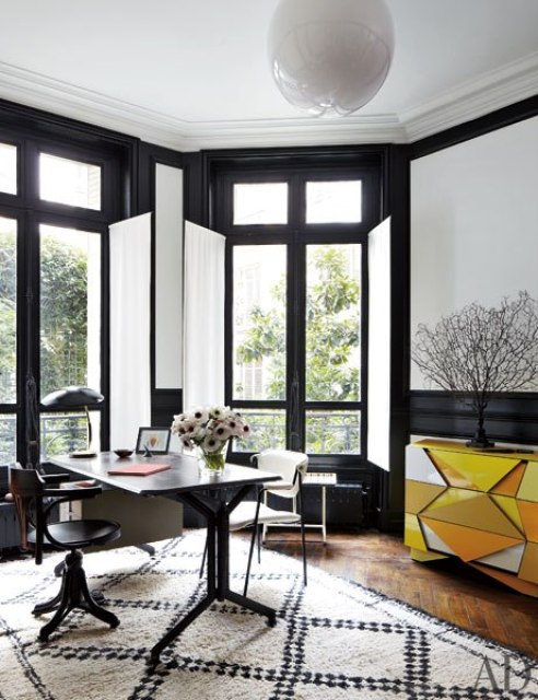 Stefano Pilati of Zegna's Paris duplex with  black and white home office with an olivetti desk and beni ourain moroccan carpet rug