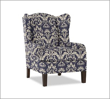 Upholstered desk chair with high back and roll back arms and blue and white ikat pattern from Pottery Barn