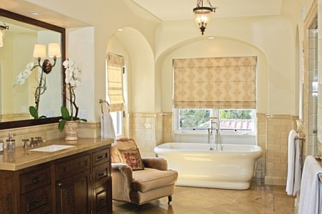 Guest bedroom gets turned into a large and luxurious master bathroom with a stand alone tub after remodeling