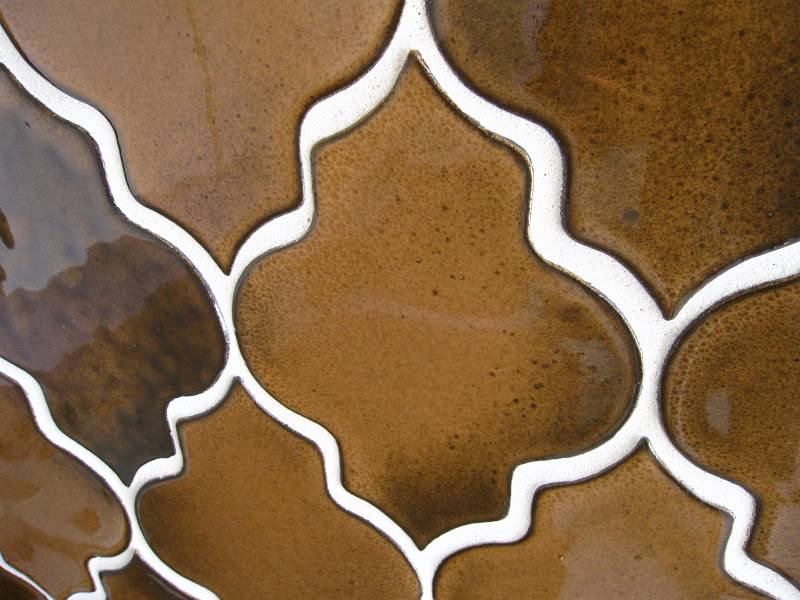 Close up of the bronze glazed tiles