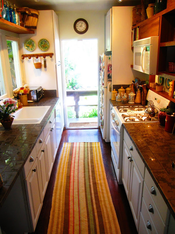 Gallery kitchen with striped runner and vintage accents