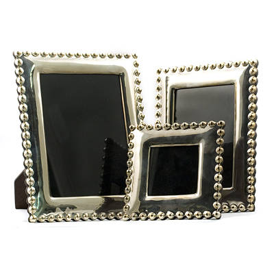 Three Madeline Weinrib Sterling Silver Picture Frames from auto