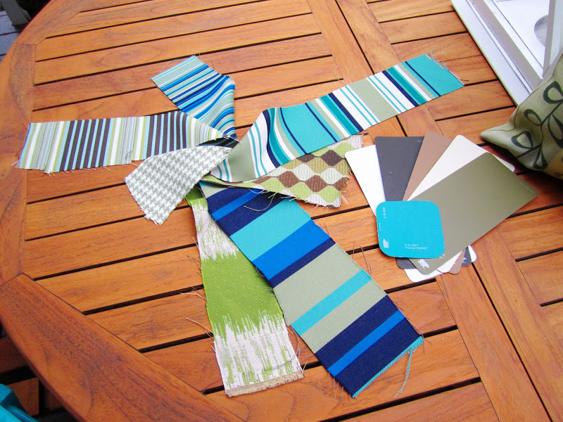 Swatches of fabric and paint on a teak patio table