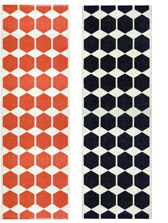 Plastic, washable rugs from Brita Sweden in orange and black hexagon pattern