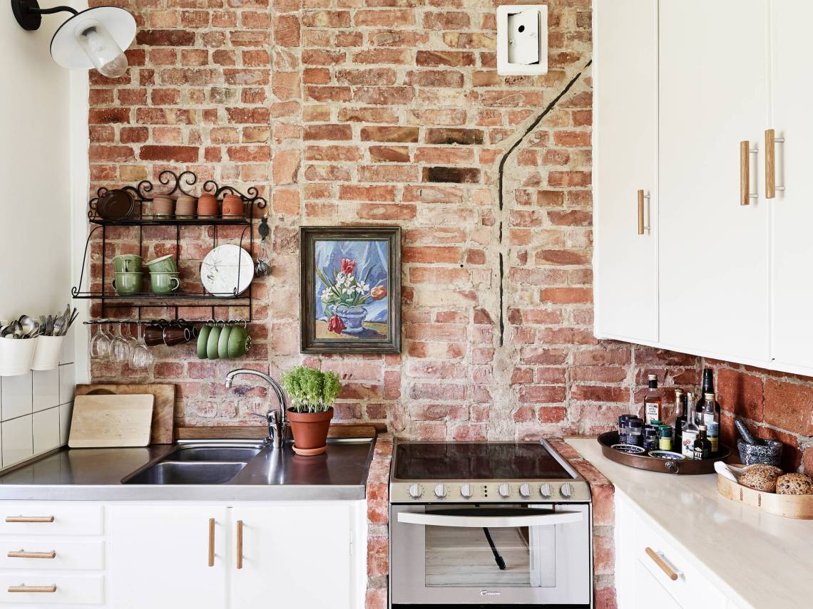 Brick wall kitchen via cocolapinedesign com
