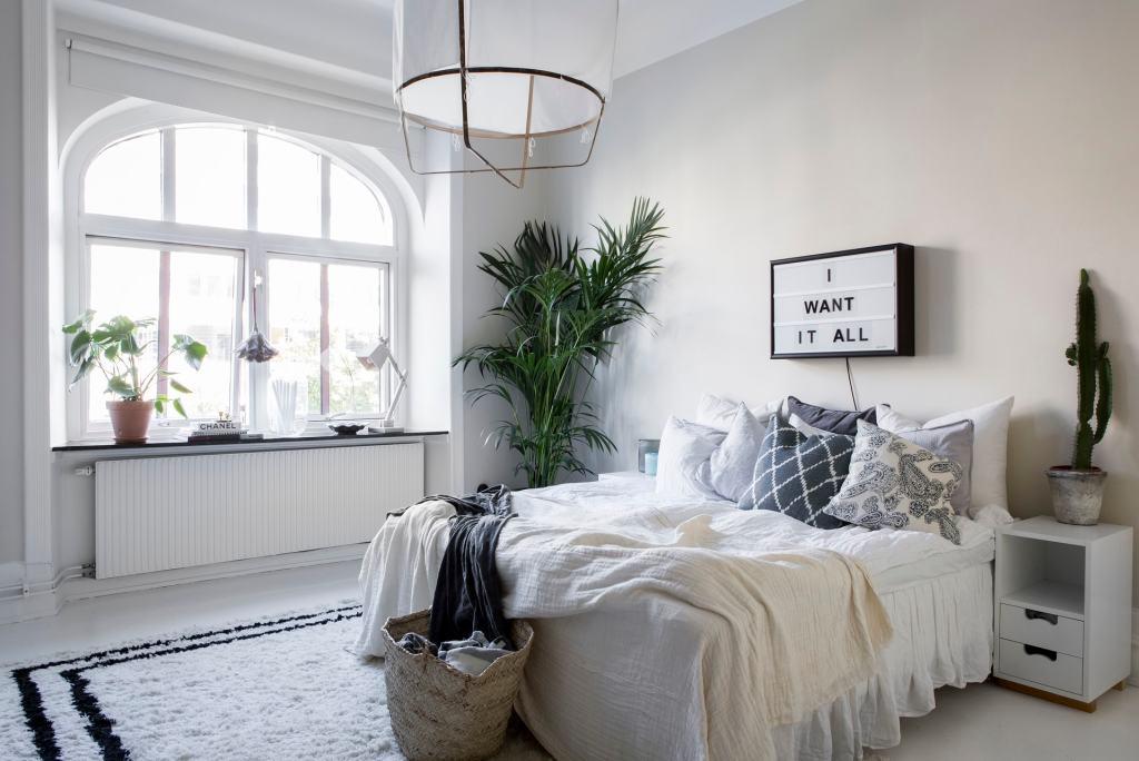 Cozy apartment with black wing doors - via Coco Lapine Design blog