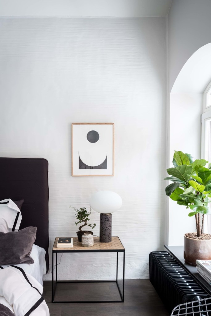 Exclusive home with an exposed brick wall - via Coco Lapine Design blog