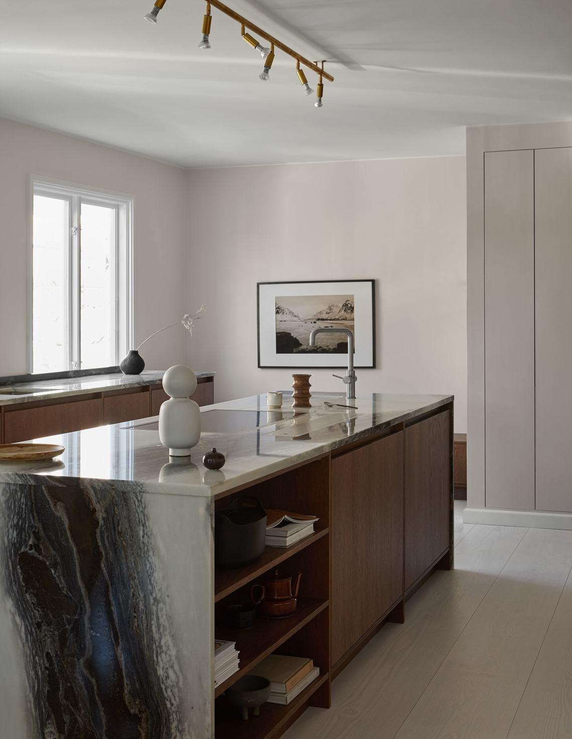 Dark oak kitchen with amazing marble countertop