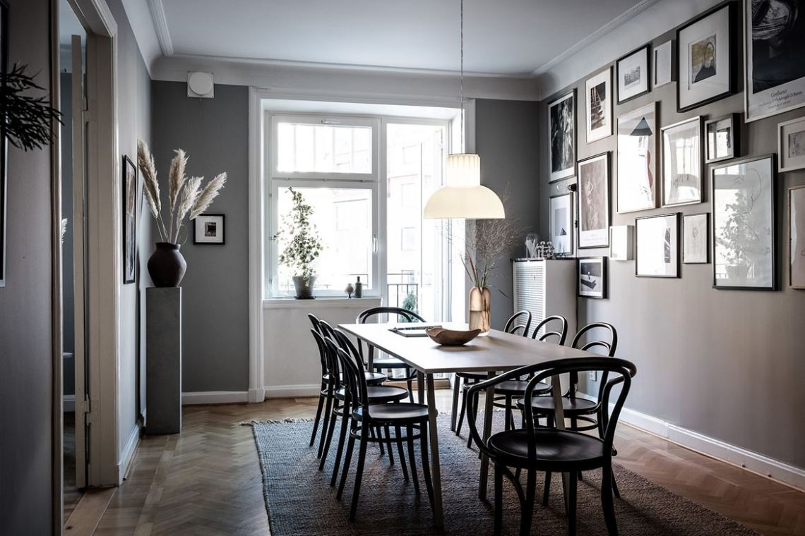 Dining room with an impressive art wall