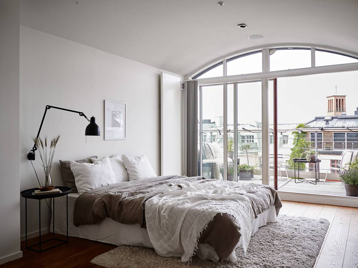 Neutral bedroom with a balcony view