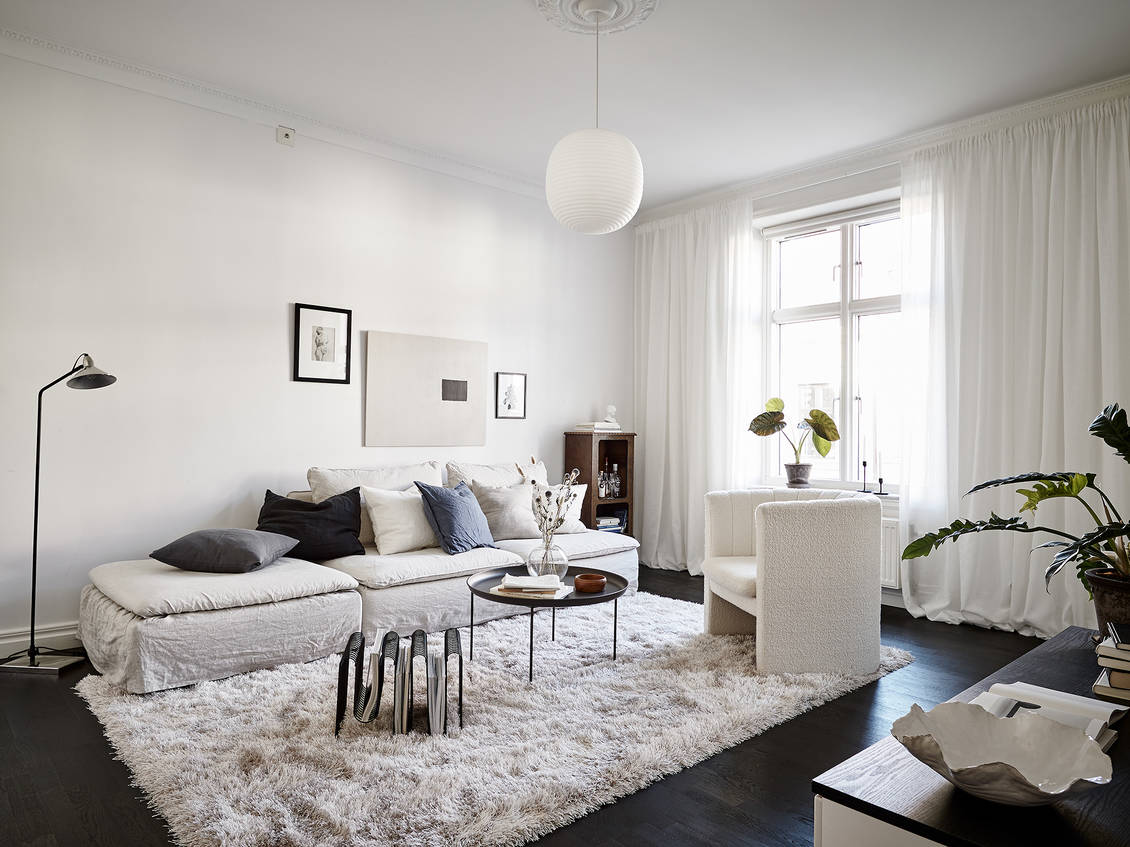 Cozy living room with white textiles