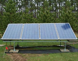 This four panel solar array measures 13.5' x 4.6', generates up to 920W of power, and costs $3500 (in Dec 2012).