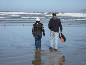 Stella and Richard walking the beach at Pismo