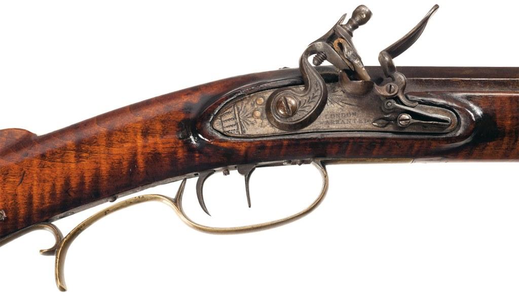 Closeup on the flintlock of an M. Martin Flintlock Kentucky Rifle