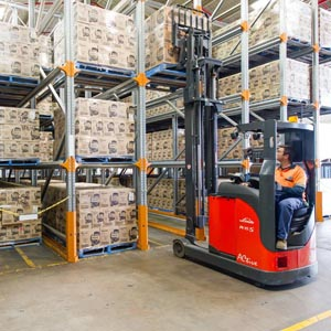 Forklift Drives Into Warehouse Shelving System