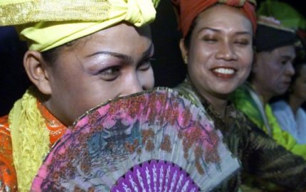 Members of the Bissu, a transvestite community from South Sulawesi, listen to their director before a performance in Jakarta July 11. The Bissu, highly-respected transvestite priests, are regarded as artists, holy people and caretakers of royal Bugis weaponry and are believed to have the ability to communicate to gods using a sacred language. The advent of Islam has significantly reduced their numbers.