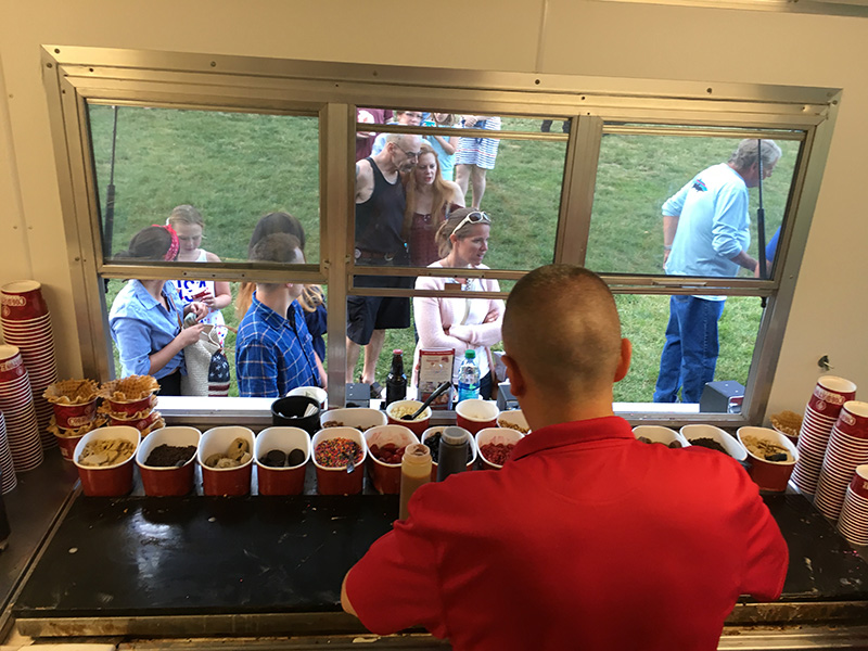 Inside Cold Stone Creamery Ice Cream Trailer Serving Guests