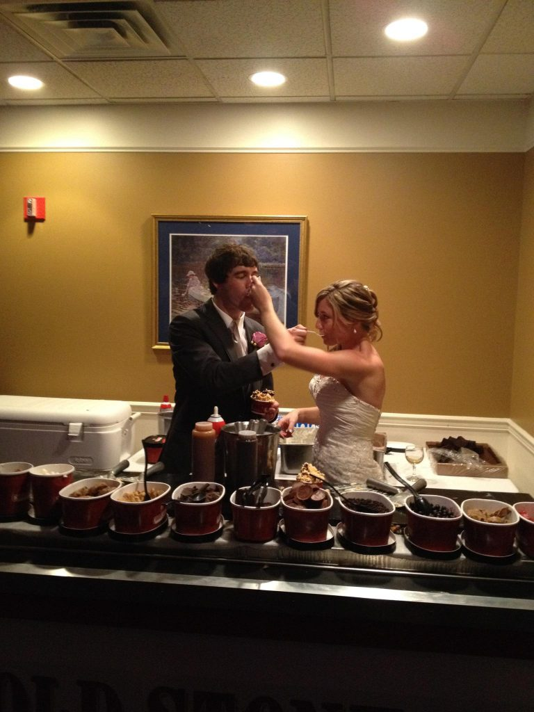 Bride and Groom sample each other's creation.