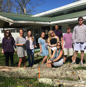 Sewanee students pause outside the Highlander Folk School site's library in the midst of rehearsals for the historical tours they will offer throughout April.   From left to right: Sarah Minnear, Noel Estopinal, Margaret Stapleton, Lexi Rouse, Tori Hinshaw, Grey Jones, Chris Murphree, Will McDowell, and John Morphis.