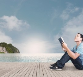 "Image: ""Reading On The Beach"", courtesy of hyena reality/FreeDigitalPhotos.net"