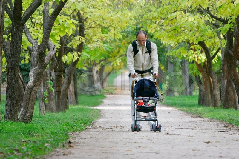 Good Toddler Stroller Father And Baby In Stroller Walking In Park Stock Photo