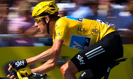 Bradley Wiggins cycling in the leader's yellow jersey