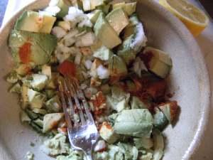 making homemade guacamole