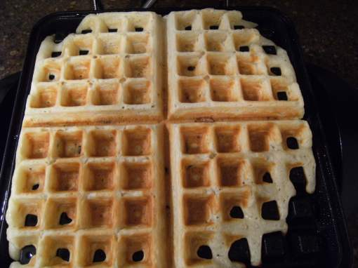 Waffles cooking on a waffle iron