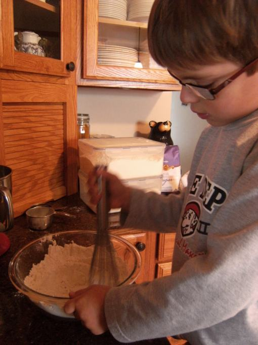 A little helper, making Egg Nog Cookie Logs!