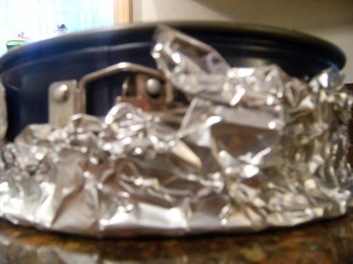 spring form pan, wrapped in aluminum foil