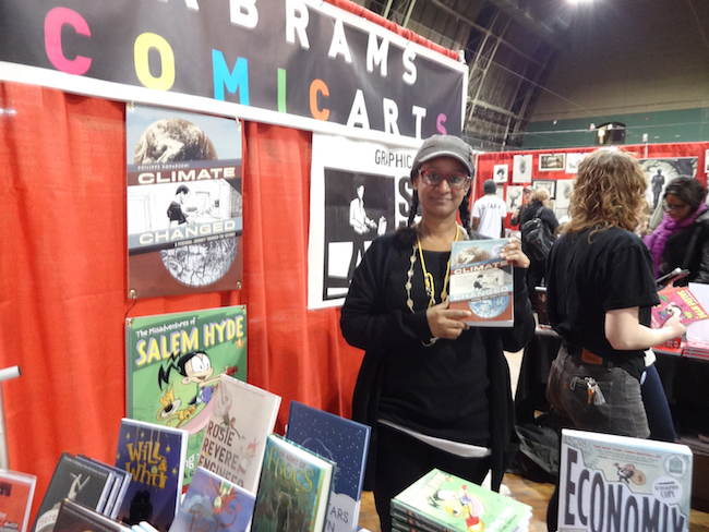 Carol Burrell shows off Climate Changed at the Abrams booth at MoCCA Fest 2014