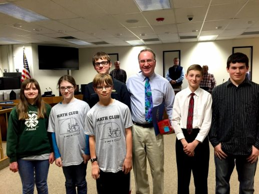 Golden Apple recipient Coach David Thomas, and KMS MathCounts team