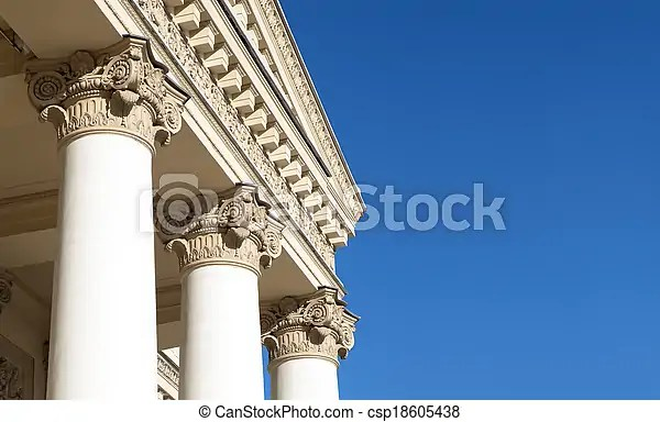 Ornately decorated corinthian columns blue sky stock photos