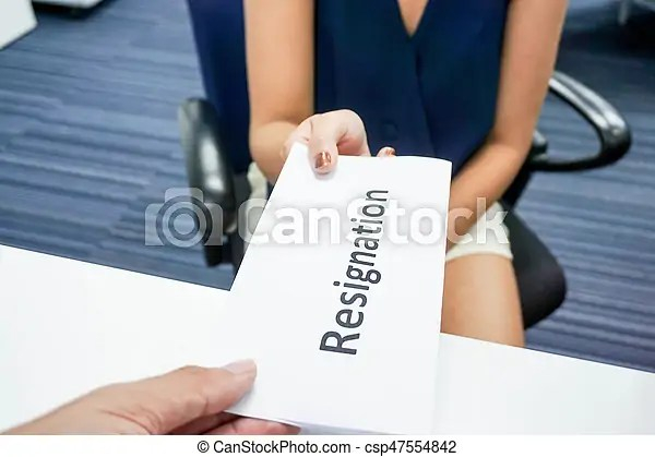 A woman submit a resignation letter to her boss