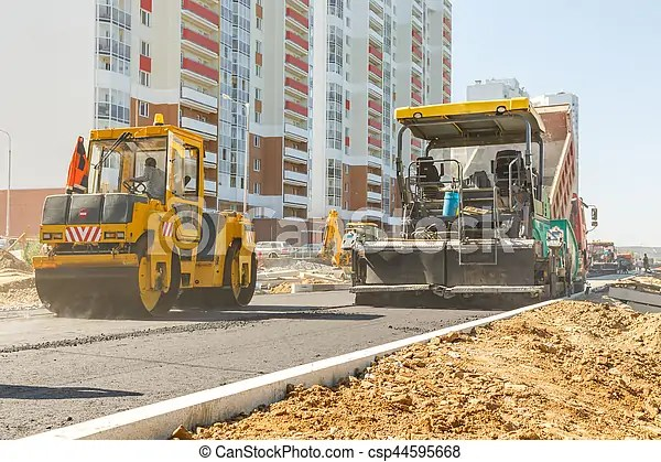 Asphalt-placing machine working on the city road - asphalting machine