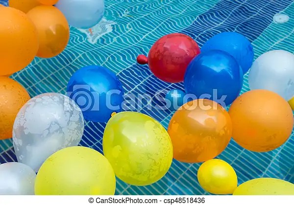 Balloons in a pool Color balloons floating in a pool