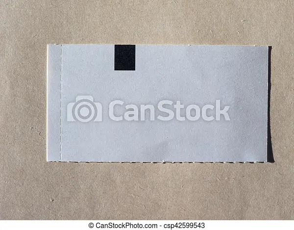 Blank ticket tag with copy space over brown paper background