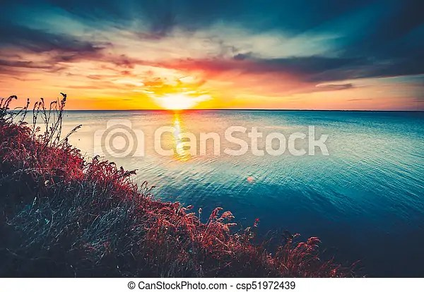Colorful and dramatic sunset sky ocean background Sunset sky