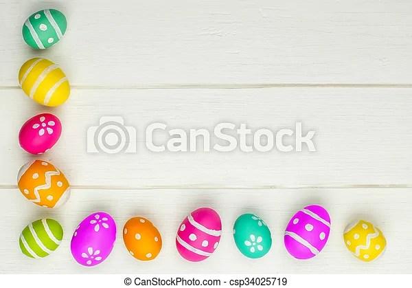Easter egg border on white wood Colorful easter egg corner border