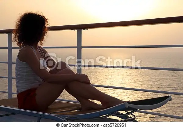 Girl Sitting On Beach Chair At Ship Deck And Looking Into