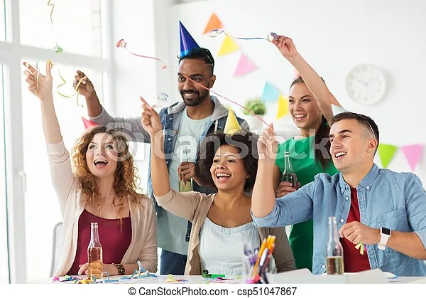 Happy team with confetti at office birthday party Corporate