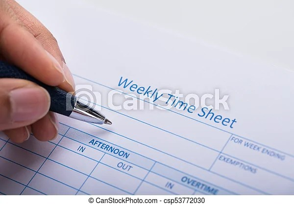 Person filling weekly time sheet with pen Close-up of a person\u0027s - weekly time sheet