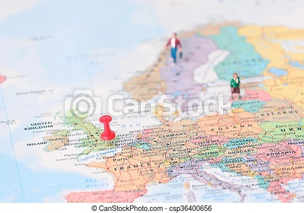 Pinned on map of london in uk and miniature travelers