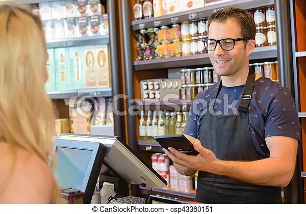 Shop assistant using calculator - shop assistan