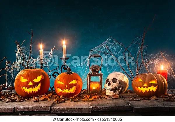 Spooky halloween background Spooky halloween pumpkins on wooden