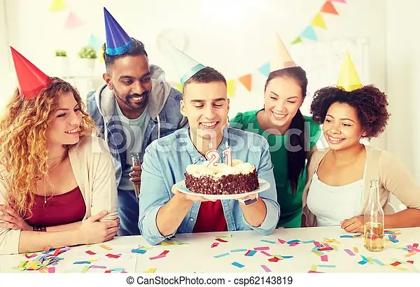 Team greeting colleague at office birthday party Corporate party