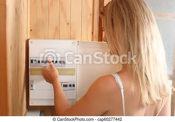 A woman switching fuses on a automatic fuse box