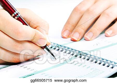 Stock Image - Business woman writing in agenda Stock Photo