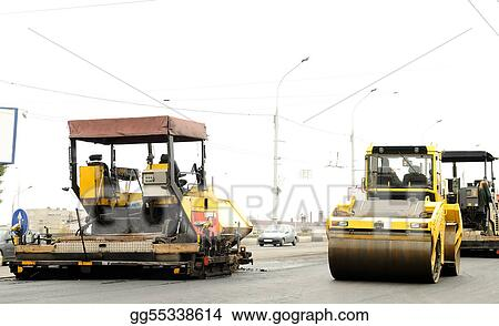 Stock Photograph - Construction equipment at road building Stock - asphalting machine
