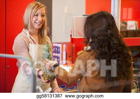 Stock Photos - Happy shop assistant with customer in supermarket - shop assistan